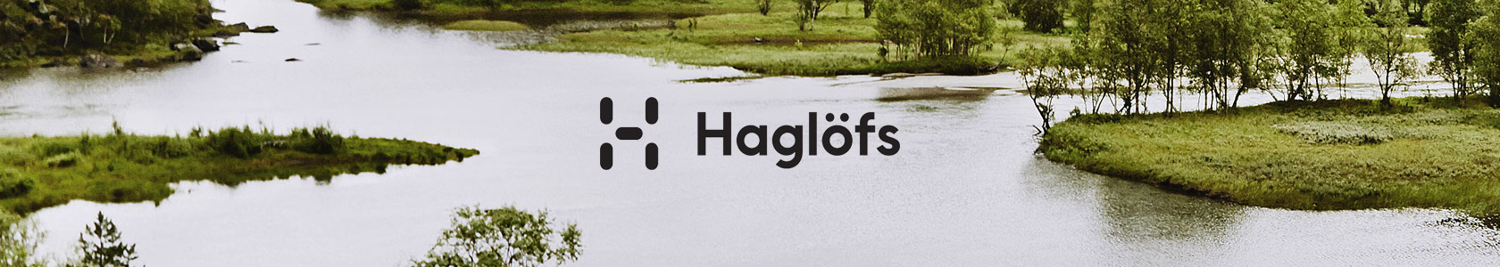 An image of a lake with the haglofs logo in the centre
