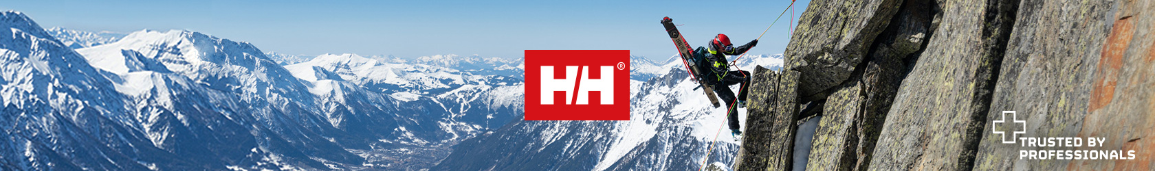 A man wearing Helly Hansen gear is climbing a rock somewhere in snowy mountains, there is a Helly Hansen logo in the centre of the image.