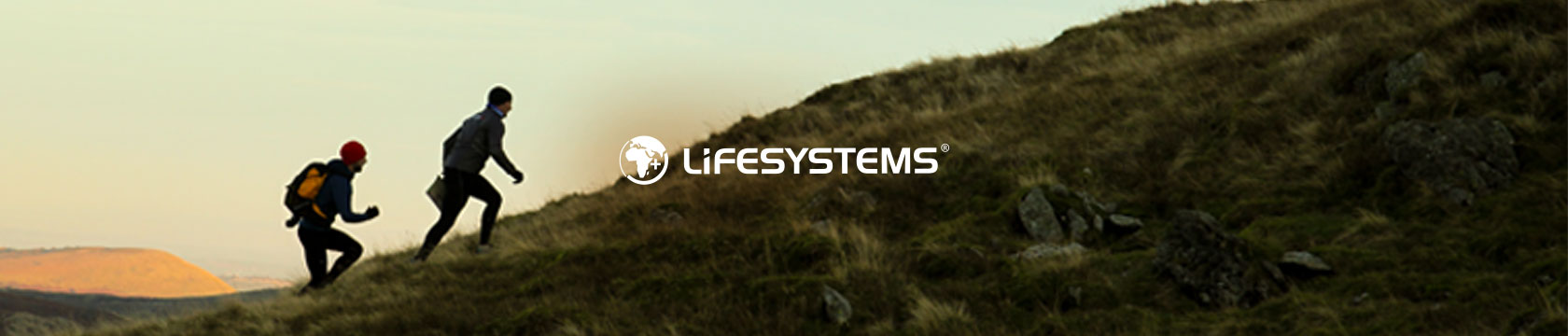 People walking up a hill with Lifesystems gear