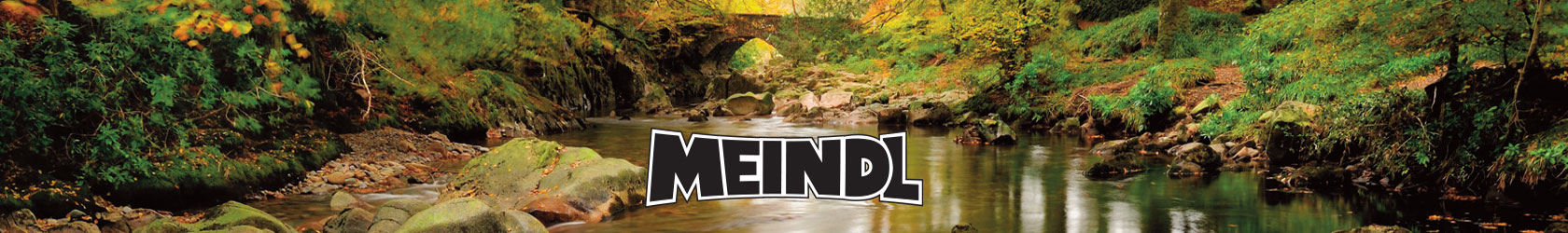 A view of the water with some rocks in the wood with Meindl brand logo in the middle.