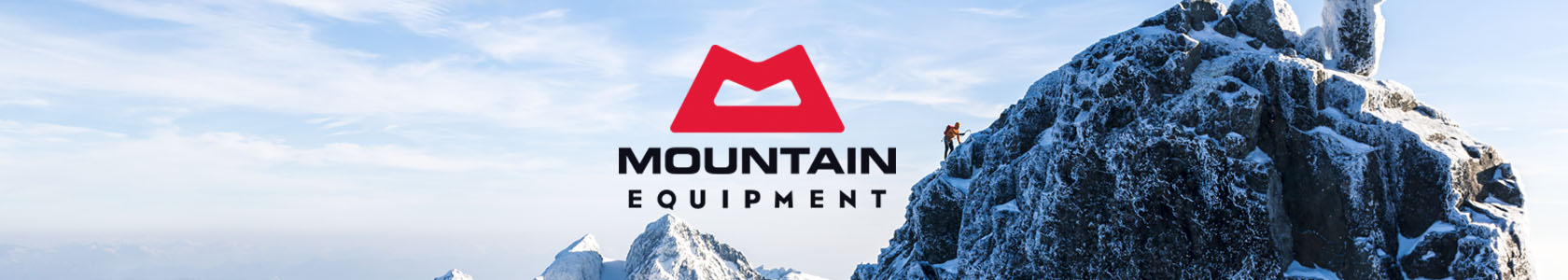 Person is walking up a snow mountain wearing Mountain Equipment gear