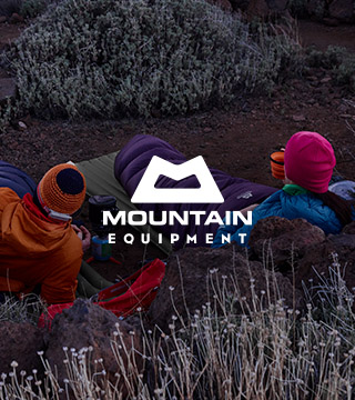 Two people wearing and equipped with the Mountain Equipment gear relaxing outdoors
