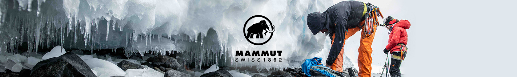 People are by a snow rock, preparing to climb, wearing and using Mammut gear.