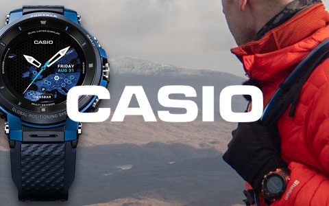 A man, wearing a Casio watch on the right with three Casio watches on the left, with the Casio brand logo in the middle.