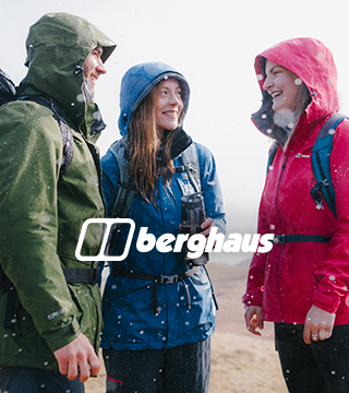 Three people wearing Berghaus jackets and backpacks under the rain.