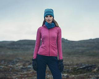 Woman keeping warm with buff clothes.