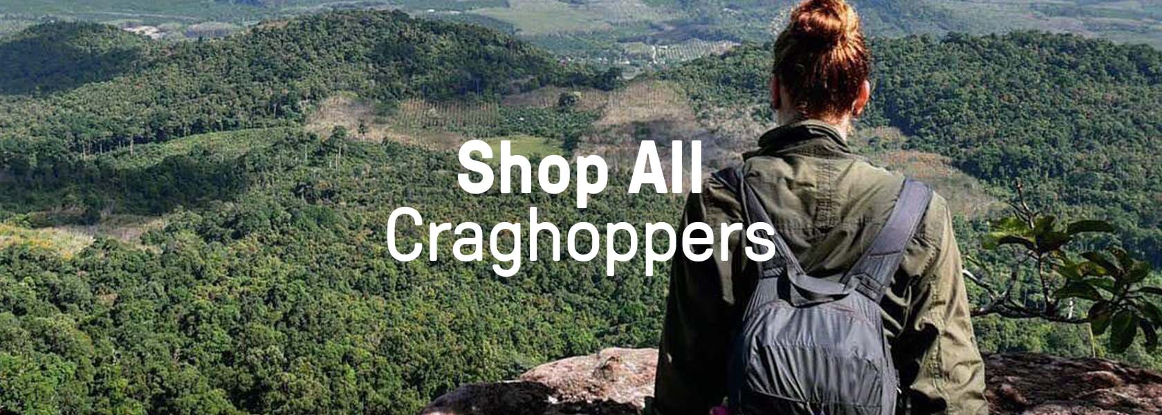 Woman sitting on the mountain wearing Craghoppers clothing