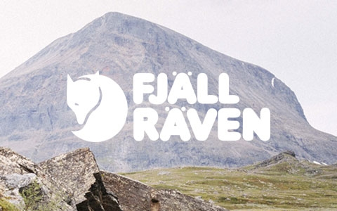 Couple hiking through the mountains with Fjallraven