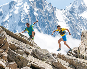 Two men running in the mountains using Garmin gear.