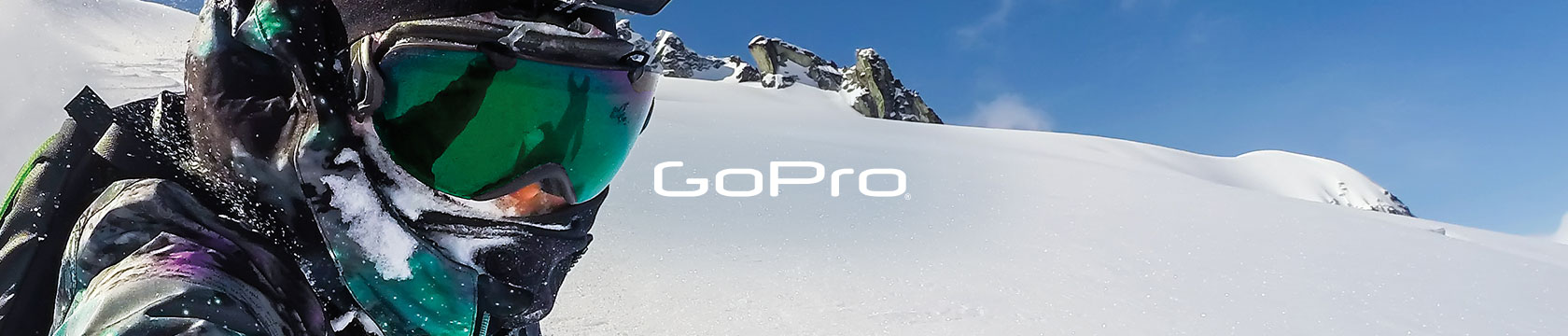 Person in snow mountains, using GoPro gear.