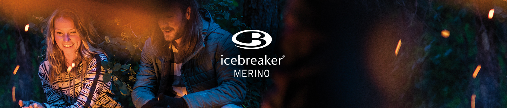 People sat around a campire wearing Icebreaker Merino apparel.