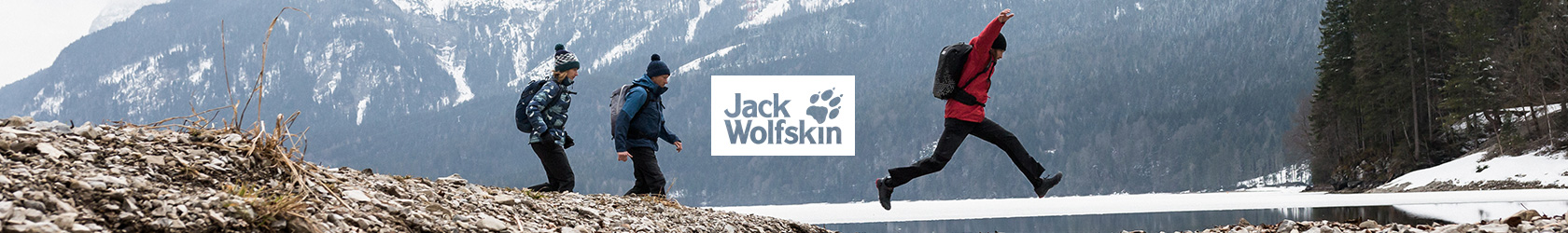 3 People in Jack Wolfskin gear are walking somewhere in the winter outdoors.