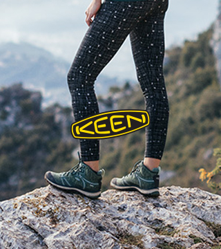 Woman standing on a mountain wearing Keen Terradora boots.