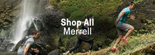 Group running up mountain, wearing Merrell gear.