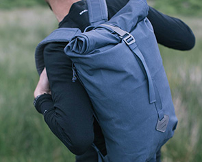 Man with a blue Millican Backpack