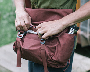 Man with red Millican backpack
