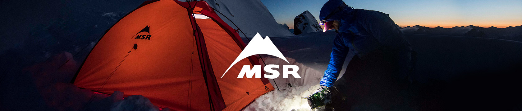 Pearson setting up an MSR tent on a snow mountain