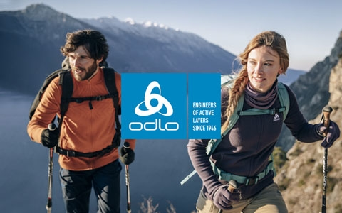 Man and a woman are in the mountains, wearing Odlo gear.