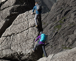 Two men climbing using Rab gear.