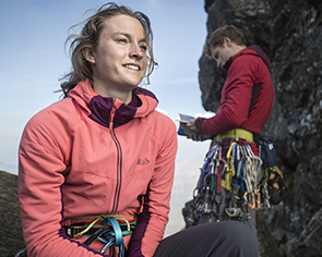 Woman and man climbing using Rab climbing gear.