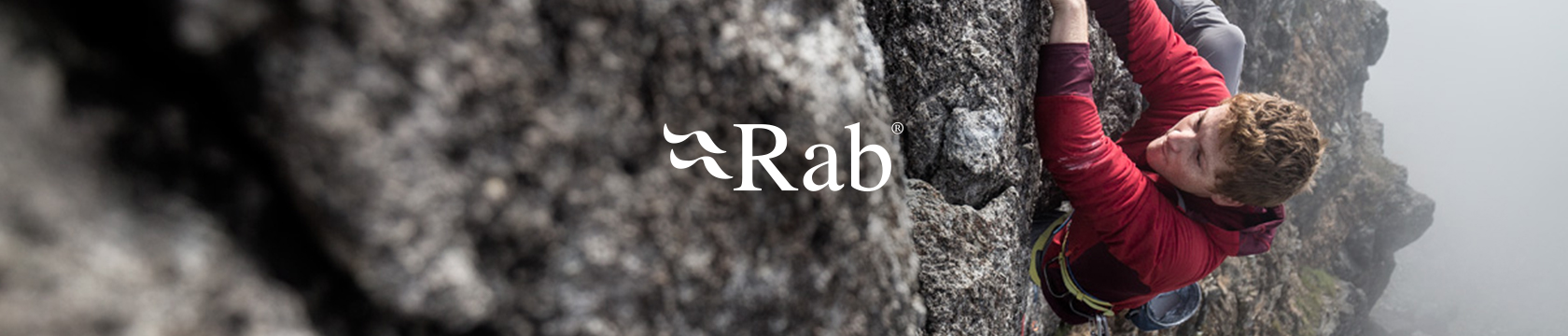 Man climbing wearing Rab gear.