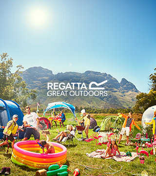 Lots of people and children in Regatta clothing picnicking.