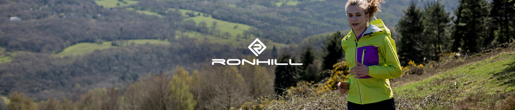 Woman running on hill wearing Ronhill gear.