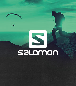 Three men climbing with Salomon gear.