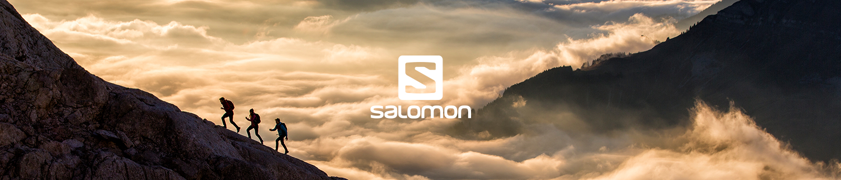Men hiking between mountain peaks wearing Salomon Apparel.