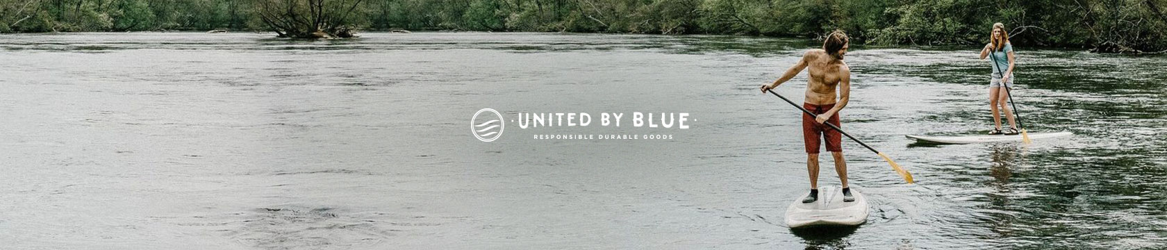 Two people on the water wearing United By Blue clothing.