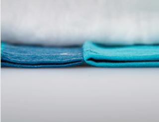 Blue fabric under cotton wool