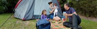 Family Enjoying Their Camping Holiday