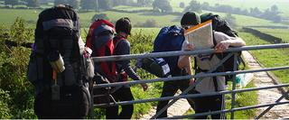 A group of camping people walking through gate
