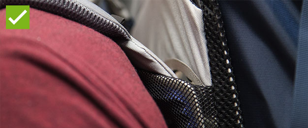 A bit of person's back with a rucksack