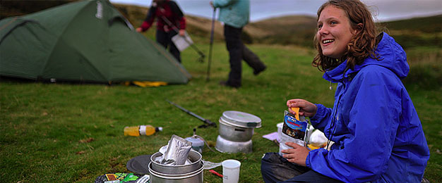 A woman eating during camping
