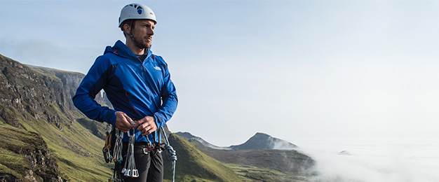 Man standing on mountain with climbing gear