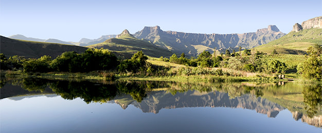 Lake against mountain drop in Northern Drakensberg Traverse South Africa