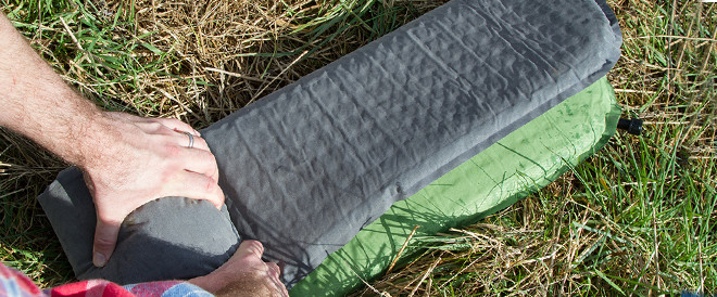 camping mat being rolled away