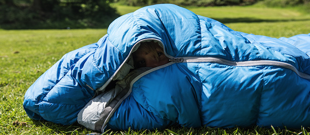 woman snuggled in sleeping bag