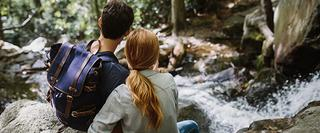 Couple Sitting by stream