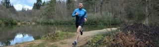Man runs through forest