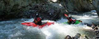 Max Your Days-two people white water rafting