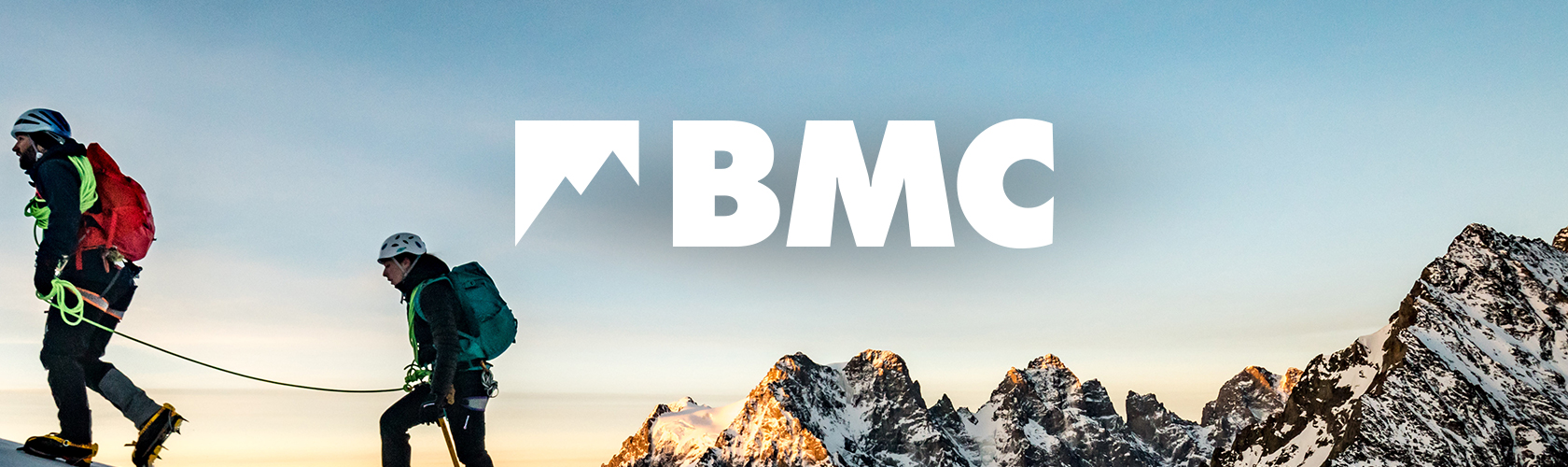 The BMC- person walking on top of mountain
