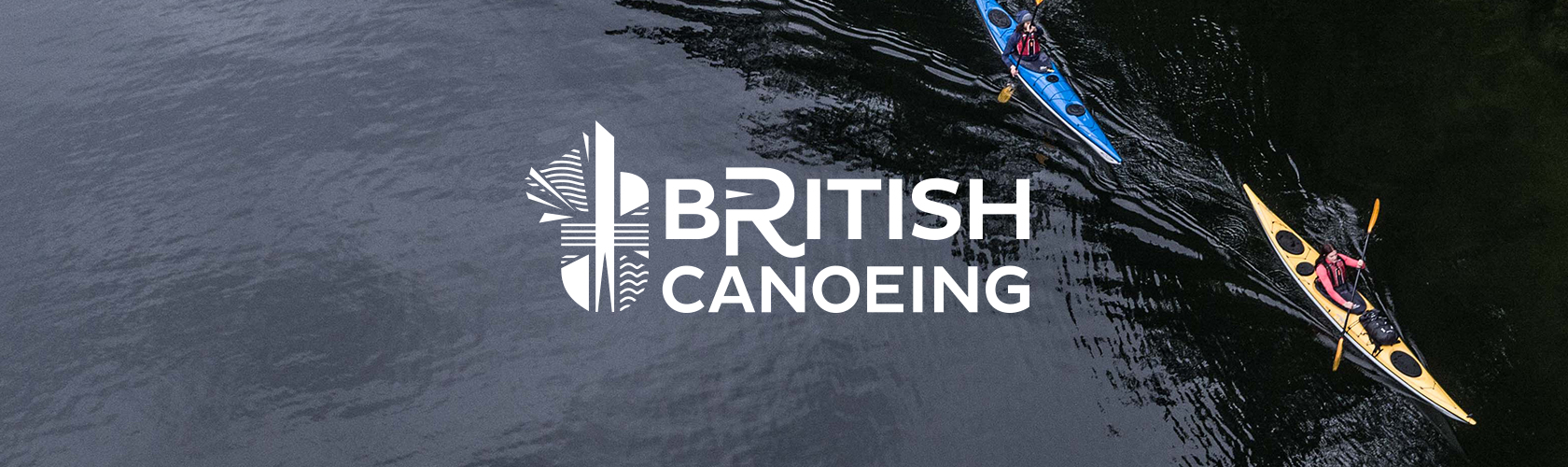 British Canoeing - person in a canoe on a lake