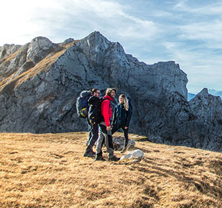 People standing on a mountain wearing and carrying DofE recommended kit.